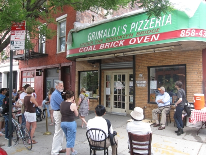 People queueing outside Grimaldi's Pizzeria in Brooklyn