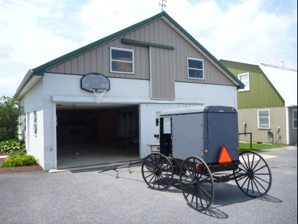 Traditional buggy outside an Amish house - photo by Rob McFarland