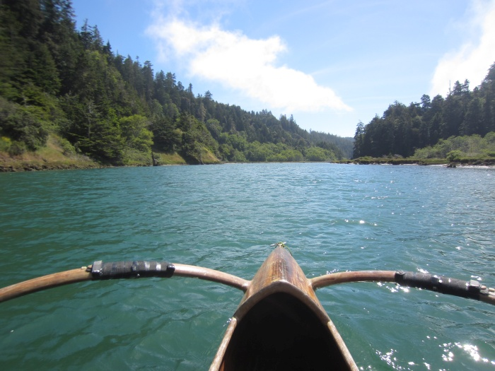 Paddling Big River Estuary in a redwood outrigger canoe - photo by Rob McFarland