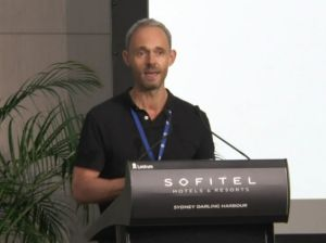 Travel writer Rob McFarland presenting at TravMedia Summit in Sydney